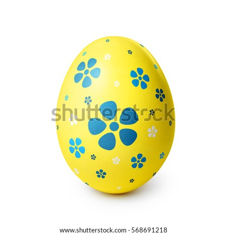 Yellow easter egg with blue flower pattern isolated on white background.  #568691218