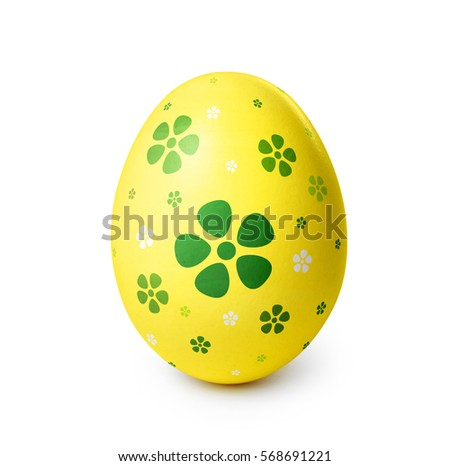 Yellow easter egg with green flower pattern isolated on white background.  #568691221