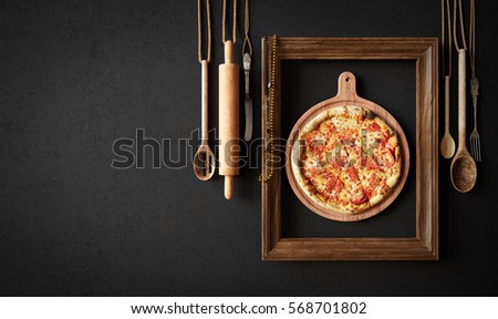Hot pizza slice with kitchen tools and frame concept close up photo