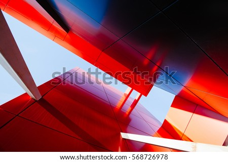 Wide angle abstract background view of steel light blue high rise commercial building skyscraper made of glass exterior. concept of successful industrial architecture and office center building Royalty-Free Stock Photo #568726978