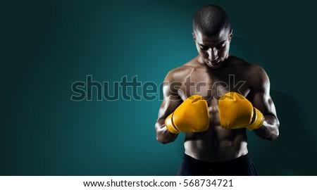Sport. Male Athlete Boxer Punching. Royalty-Free Stock Photo #568734721