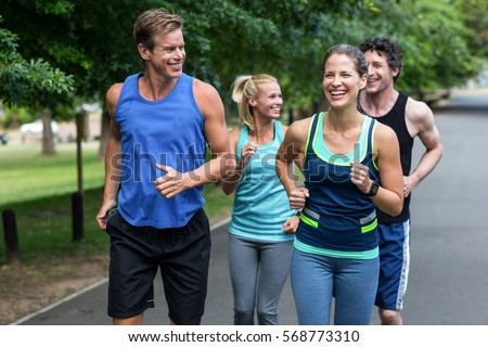 Marathon athletes running in park #568773310