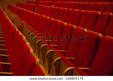 Empty rows of red chairs without people in cinema or concert hall #568804174