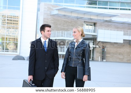 A young attractive business man and woman team at office building #56888905