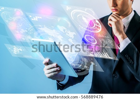 business person holding futuristic tablet PC
