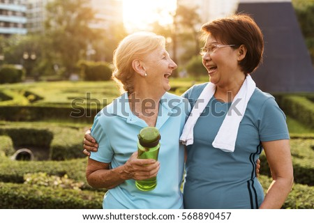 Senior Adult Friendship Exercise Fitness Strength Royalty-Free Stock Photo #568890457