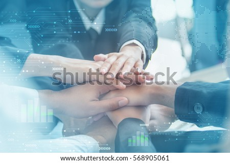 Concept of teamwork. business people joined hands Royalty-Free Stock Photo #568905061