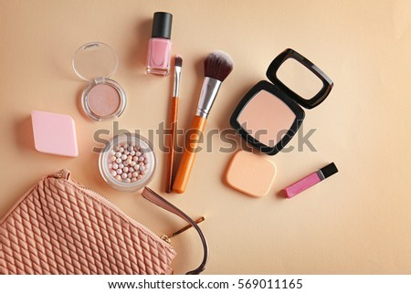Cosmetic bag and makeup products on color   background #569011165