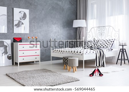 Spacious stylish designed woman's bedroom with high heels in the middle #569044465