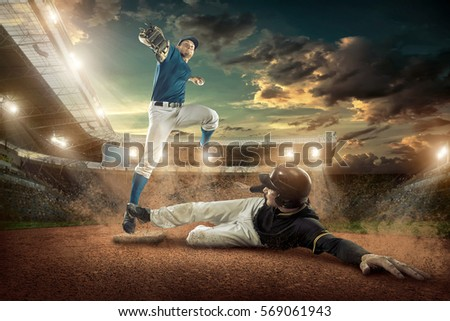 Baseball players in action on the stadium. #569061943