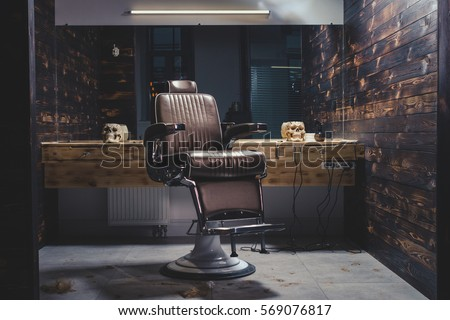 Stylish Vintage Barber Chair In Wooden Interior. Barbershop Theme #569076817