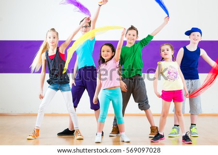 Children dancing modern group choreography with scarfs #569097028