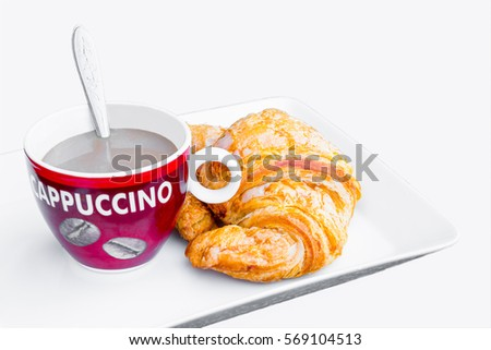 cup of coffee with croissant on white background #569104513