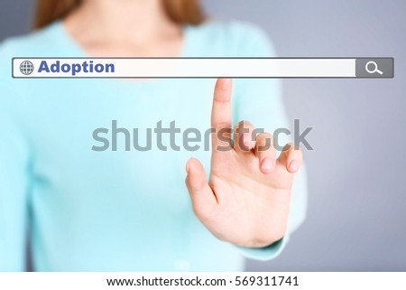 Adoption concept. Female hand pushing on search box  #569311741