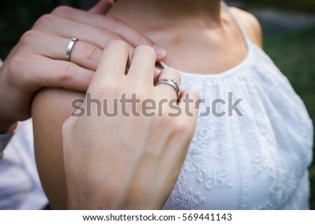 Hands of married couple with rings  #569441143