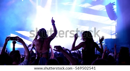Crowd in a concert. Royalty-Free Stock Photo #569502541