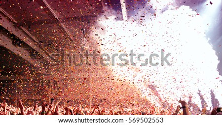 Crowd in a concert. Royalty-Free Stock Photo #569502553