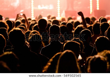 Crowd in a concert. Royalty-Free Stock Photo #569502565