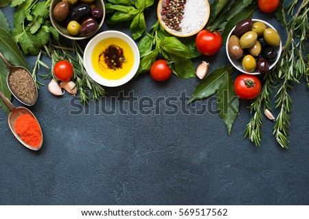 High Angle View of Italian Food IngredientsBbackground with Herbs, Olives, Oil and Tomatoes. Empty space for your text Royalty-Free Stock Photo #569517562