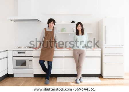 portrait of young asian couple in the kitchen #569644561