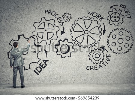 Businessman standing with back and drawing concept of teamwork and cooperation #569654239