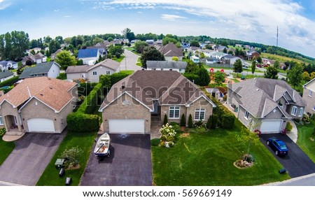 Residential neighborhood subdivision skyline Aerial shot  Royalty-Free Stock Photo #569669149