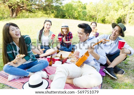 happy young friends group enjoying  picnic party  #569751079