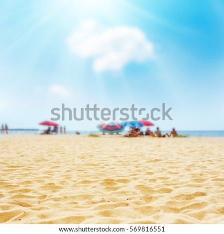 sand on the beach and sun in blue sky. soft focus on bottom of picture