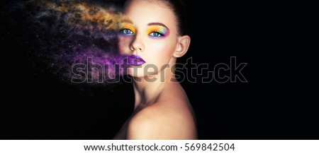 Fashion model girl portrait with colorful powder make up. Beauty woman with bright color makeup. Close-up of Vogue style lady face, Abstract colourful make-up, Art design. Black background. copy space #569842504