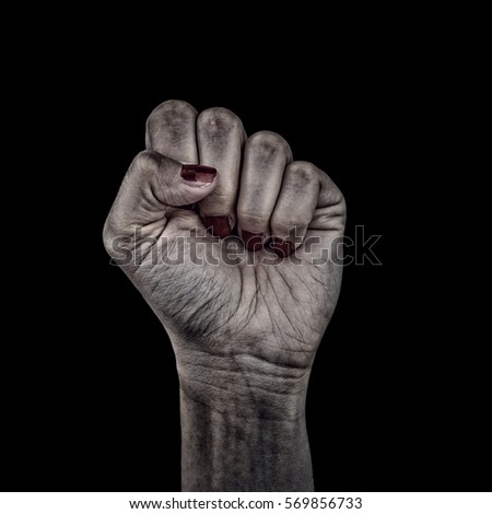A grunge abstract photograph of a woman raising her hard worked fist in defiance.