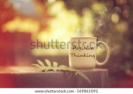 Positive thinking concept: having fun while enjoying a hot cup of coffee outdoors Royalty-Free Stock Photo #569861092