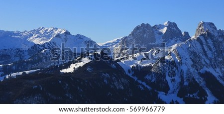 Snow covered mountains Gummfluh and Le Rubli. View from the Rellerli ski area, Swiss Alps. Mount Gummfluh, Le Rubli and others in winter. #569966779