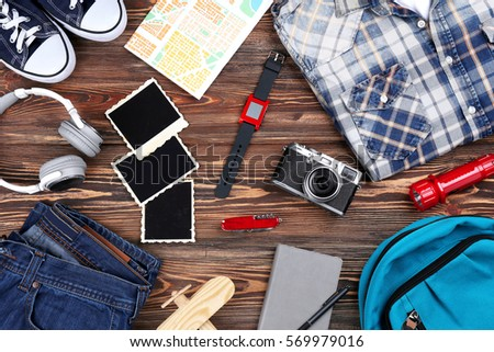 Outfit for travelling on wooden background #569979016