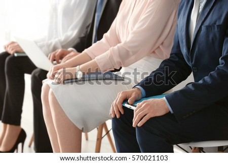 Group of people waiting for job interview indoors Royalty-Free Stock Photo #570021103