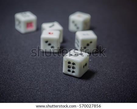 white dice casino/toy, dark background #570027856