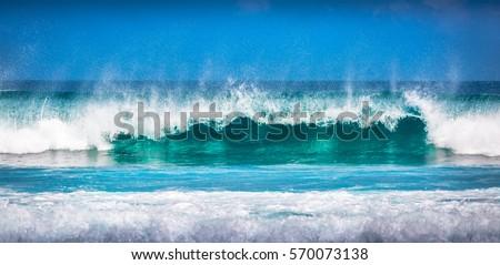 Panorama photo of splashing blue wave