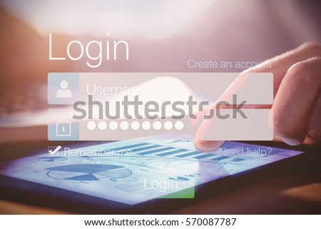Cropped image of hand using digital tablet at desk #570087787