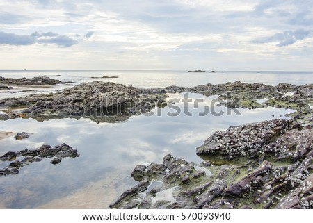 rocks on the beach and sunset natural seascapes #570093940