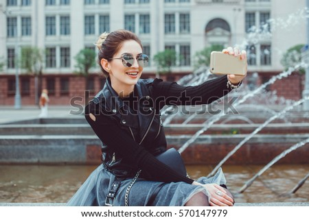 Pretty make selfie in the street, happy smile face, outdoor portrait, hipster style, sunglasses
