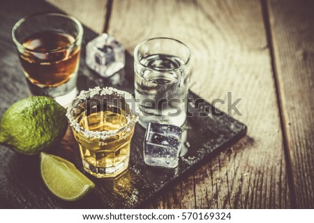 Selection of alcoholic drinks on rustic wood background Royalty-Free Stock Photo #570169324