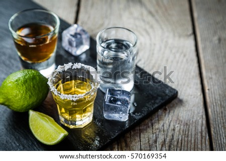 Selection of alcoholic drinks on rustic wood background Royalty-Free Stock Photo #570169354