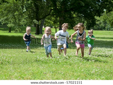 a child or children at play outdoors in a park #57021151