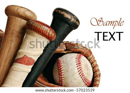 Wooden baseball bats with ball and glove on white background with copy space.  Macro with shallow dof.  Focus on taped handle. Royalty-Free Stock Photo #57023539