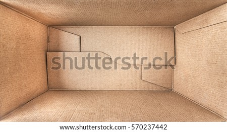 Empty open rectangular cardboard box close up. Royalty-Free Stock Photo #570237442