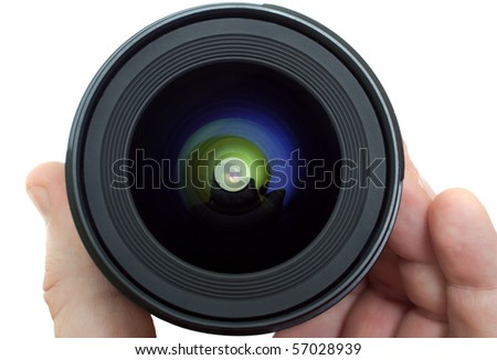 lens in a man's hand isolated on white #57028939