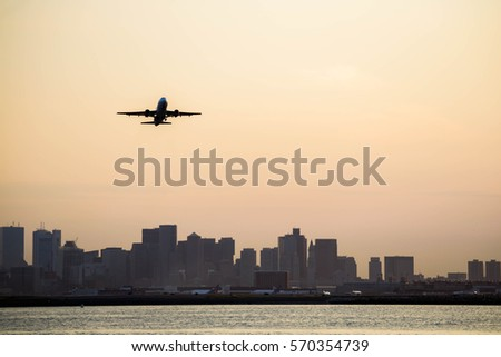Airplane taking off from Boston Logan International Airport #570354739