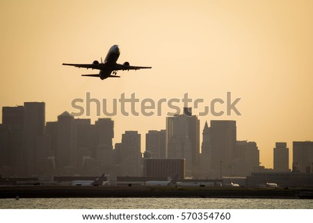 Airplane taking off from Boston Logan International Airport #570354760