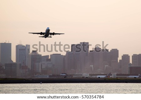 Airplane taking off from Boston Logan International Airport #570354784