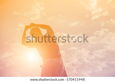 Silhouette of man praying over beautiful sky background #570415948