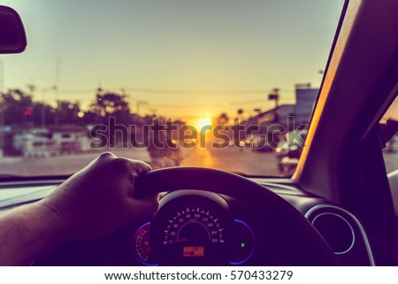 image of people driving car on day time for background usage.(take photo from inside focus on driver hand) #570433279